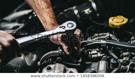 Hand of mechanic with wrench and car. Stock photo © Kurhan