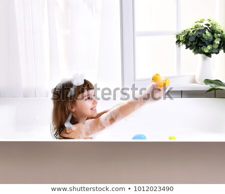 A girl and a boy at the bathtub Stock photo © bluering