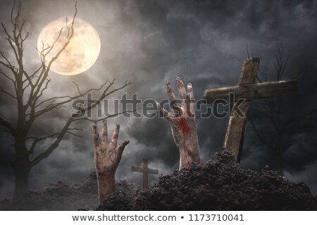 Stock photo: zombie hand popping up
