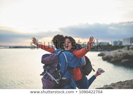 Adventure couple stands sideways Stock photo © deandrobot