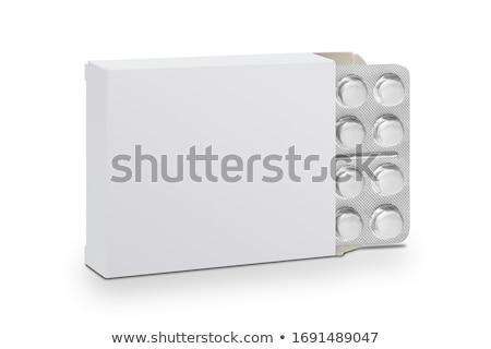 Medicina bianco pillola finestra isolato blu Foto d'archivio © Klinker