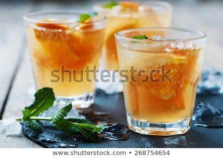 Frescos cóctel naranja menta hielo atención selectiva Foto stock © Yatsenko