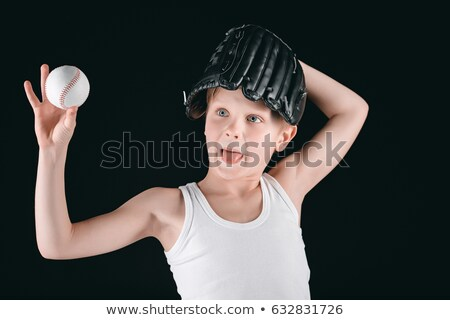 portrait of grimace boy with baseball equipment isolated on black Stock photo © LightFieldStudios
