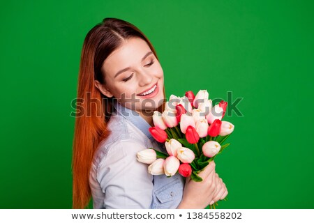 Stockfoto: Cute Happy Young Redhead Lady Holding Flowers