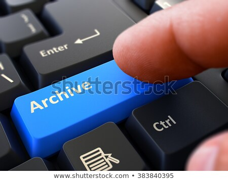 Pressing Blue Button Archive on Black Keyboard. Stock photo © tashatuvango
