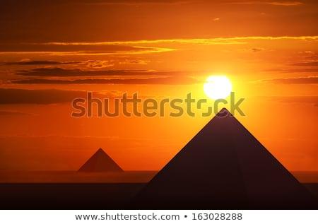 pyramids at sunset stock photo © givaga