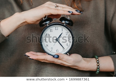 Stock photo: Pregnant female with vintage alarm clock