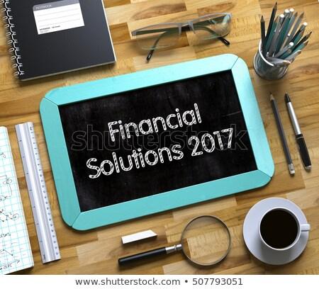 Financial Solutions 2017 - Text on Small Chalkboard. 3D. Stock photo © tashatuvango