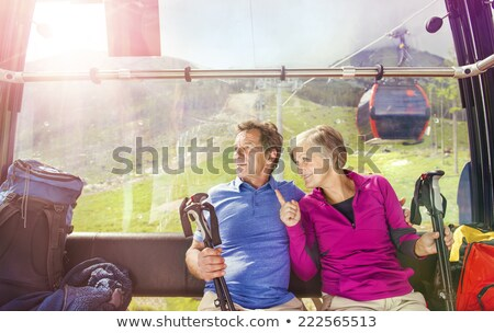 senior couple in mountain cable car Stock photo © IS2