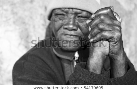 Black And White Photo Of An Senior African Woman With Folded Hands - Focus On The Weathered Hands Stok fotoğraf © Tish1