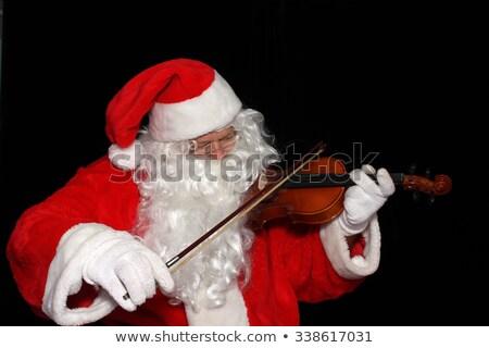 Sonriendo papá noel jugando violín blanco música Foto stock © wavebreak_media