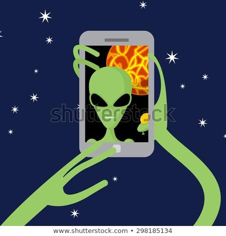 Espaço alienígena telefone fundo planeta mão Foto stock © popaukropa