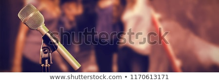 Microphone with stand against happy women with male friends in background Stock photo © wavebreak_media