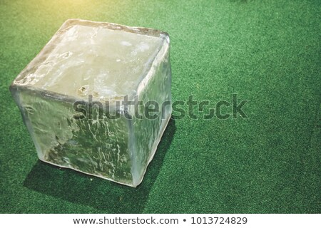 rows of transparent pieces of glass ice on a blue background Stock photo © artjazz