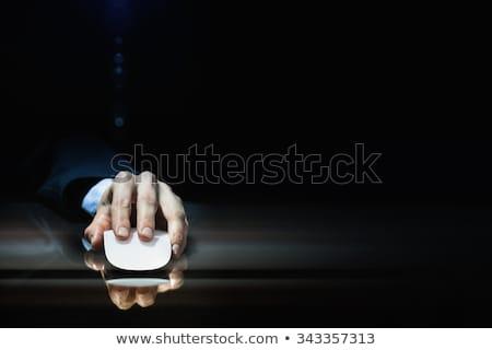 Hand using mouse on dark background Stock photo © ra2studio