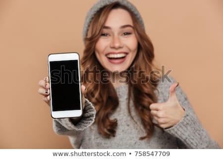 Mosolyog barna hajú nő lezser ruházat tart Stock fotó © deandrobot
