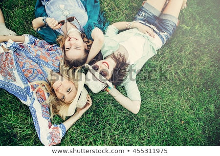 two pretty young girls friends having fun at the park stock photo © deandrobot
