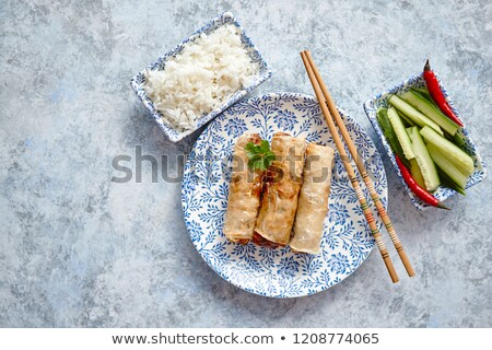 orginal asian deep fried spring rolls placed on beautiful oriental style plate stock photo © dash