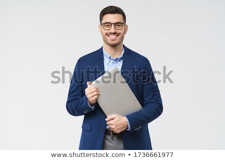 businessman portrait holding glasses stock photo © minervastock