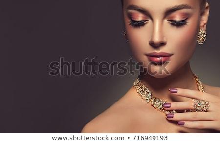 Bela mulher brinco dedo anel beleza jóias Foto stock © dolgachov