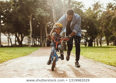 Father Teaching Son To Ride Bicycle Stock photo © Lopolo