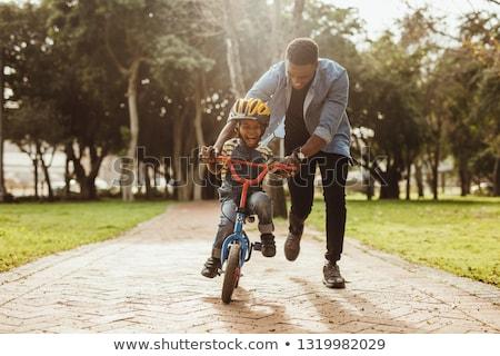Padre insegnamento figlio bicicletta strada uomo Foto d'archivio © Lopolo