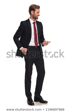 relaxed businessman holds pocket and looks to side stock photo © feedough