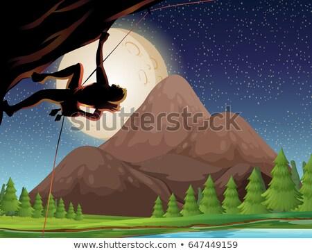 Foto stock: Rock Climbing On Fullmoon Night