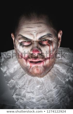 Mérges férfi ijesztő bohóc halloween jelmez Stock fotó © deandrobot