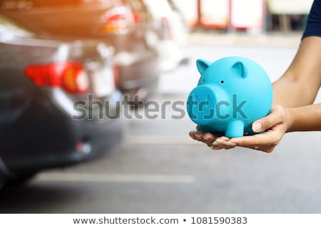 Woman Holding Blue Car And Coins Stock photo © AndreyPopov
