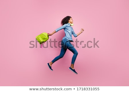 photo of beautiful african american students wearing backpacks h stock photo © deandrobot