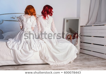 beautiful elegant redhaired woman in a white dress stock photo © doodko