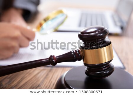 Mallet In Front Of A Judge Analyzing The Invoice Stock photo © AndreyPopov