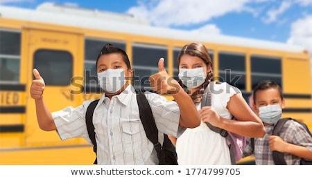 Genç koyu esmer kız erkek yürüyüş okul otobüsü Stok fotoğraf © feverpitch