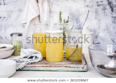 Chicken bone broth in a glass jar on a table Stock photo © madeleine_steinbach