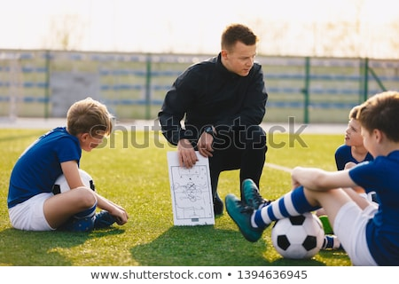 Football Coach Coaching Kids. Young Soccer Players Listening Coa Stock photo © matimix