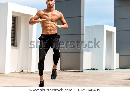 Adult Man Training ABS and Legs Doing High Knee Tap Stock photo © diego_cervo