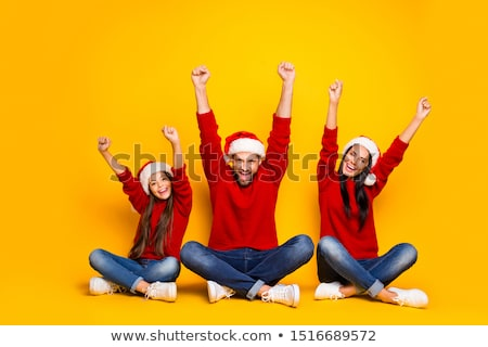 Photo of cheerful couple man and woman sitting on floor over whi Stock photo © deandrobot