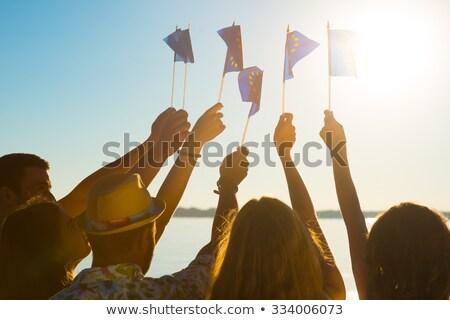 Woman hand waving the flag of European union  Stock photo © manaemedia