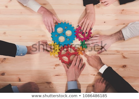 Business team connect pieces of gears. Teamwork, partnership and integration concept. Stock photo © alphaspirit