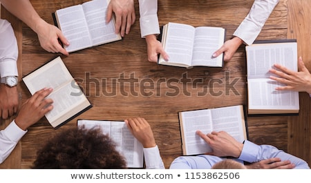 Group Of People Reading Holy Books Stock photo © AndreyPopov
