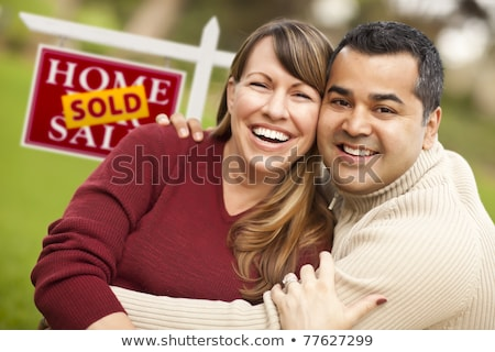 Mixed Race Young Adult Couple In Front of House and For Sale Rea Stock photo © feverpitch