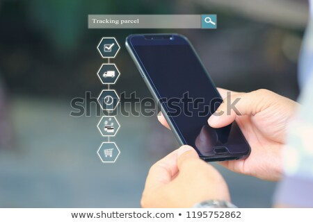 Person Holding Smartphone Showing Parcel Tracking On Screen Stock photo © AndreyPopov