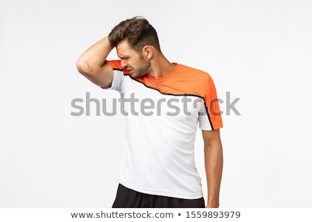 Young sportsman raise arm and smell stinky armpit after hard productive workout in gym, grimace, cri Stock photo © benzoix