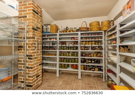 Various jars with Home Canning Fruits and Vegetables jam on glass shelves Stock photo © ruslanshramko