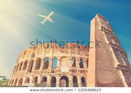Airplane Flying Over Tower Of Coliseum In Italy Stock photo © AndreyPopov