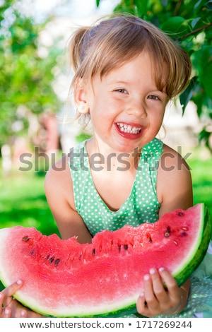 Pequeno menina grande fatia melancia Foto stock © Illia
