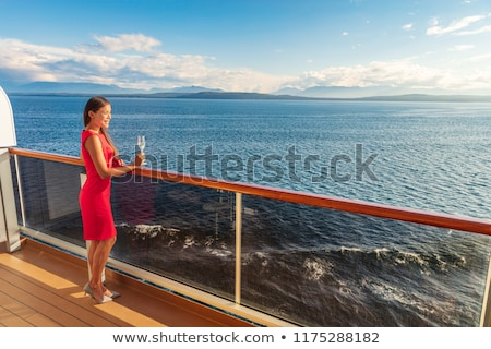 Luxury cruise ship travel elegant Asian woman drinking wine glass drink enjoying watching sunset fro Stock photo © Maridav