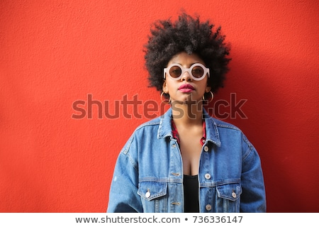 Young girl with attitude wearing sunglasses stock photo © darrinhenry