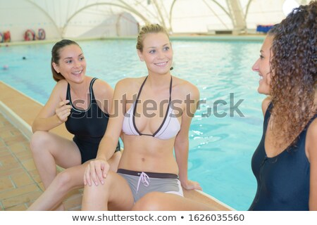 woman sat by poolside stock photo © photography33